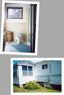 Composting toilet review of Sun-Mar Centrex 2000 installed in cottage in Minaki, ON