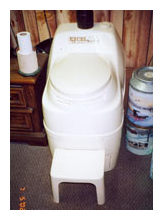 Composting toilet review of Sun-Mar Excel NE installed at a residence in Wisconsin north woods