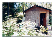 Composting toilet review of Sun-Mar Excel NE installed at camp on Lake Huron