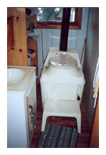 Composting toilet review of Sun-Mar Excel NE installed at cottage on Lae of Many Islands, ON